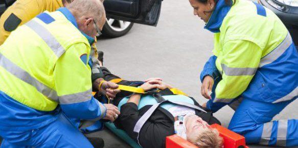 Woman in head brace on stretcher